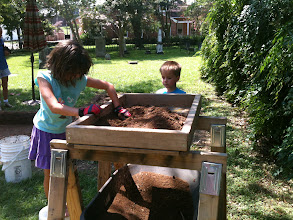 Photo: Elizabeth and Michael Seidemann screening dirt for their father a Historic Highland Cemetery in Baton Rouge.