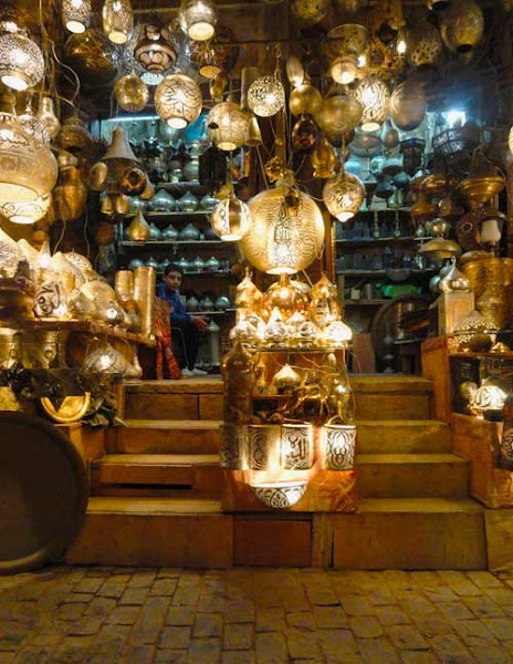 Photo: Day 131 +G+ 365 Project : 10 May 2012 Khan Khalili Market, Cairo, Egypt  This is the shop of one of our favorite vendors in Khan Khalili market. Every now and again, we take a visit the souk to get gifts. This particular spot is one of the oldest parts of the bazaar, dating back to 1382. Over the years, as we visit this vendor, he always has something new to offer. This time, he is has all these ornate lights with arabic writing. Very pretty.  #365project #egypt #cairo #market #lightning #creative366project