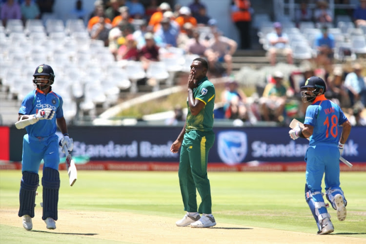Lungisani Ngidi of South Africa reacts as Shikhar Dhawan of India and Indian captain Virat Kohli take a run during the 3rd Momentum ODI match between South Africa and India at PPC Newlands on February 07, 2018 in Cape Town, South Africa.