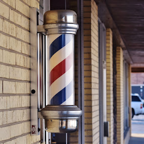 Barber Pole Under Glass by John Tuttle - Artistic Objects Business Objects ( brick, barber shop, barbershop, white, stripes, red, pole, blue, helical, outdoors, helix, glass, bricks, barberpole, wall, twisting,  )