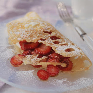 Lacy Pancakes with Strawberries and Honey.