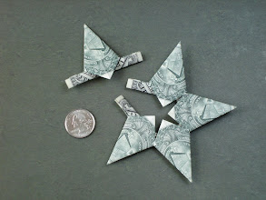 Photo: Model: Money Star;  With 1 of the sections removed;  Creator: Trang (Tracy) Chung;  Folder: William Sattler;  5 dollars, one for each point section;  Publication: Annual Collection 2002 (OrigamiUSA) http://www.origami-usa.org/