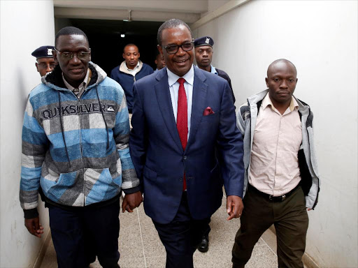 Former governor Evans Kidero and Maurice Okere walking to court room on August 8./REUTERS