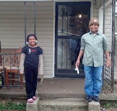 Photo: Kaleya & Q in front of Mama Frances' house