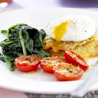 Poached Eggs and Roasted Tomatoes with Potato Pancakes.