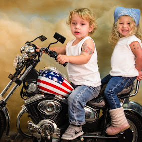 Studio portrait on the motorcycle by John & Sharon Green - Babies & Children Toddlers ( studio, tattoos, motorcycle, kids on bikes, toddlers )