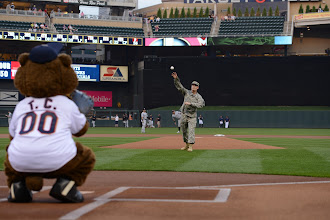 "Photo: Maj. John Donovan lets loose the first pitch at Target Field on Sept. 1, 2015. ""Walking out to the mound I was very nervous thinking about all the eyes in the stadium looking at me,"" said Donovan. ""We've all seen videos of ceremonial pitches that have gone awry and I didn't want my pitch to end up on some YouTube bloopers reel."" Minnesota National Guard photo by Army Staff Sgt. Patrick Loch/ Released"