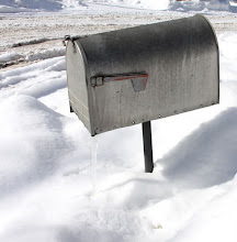 Photo: Mailbox in snow with icicle