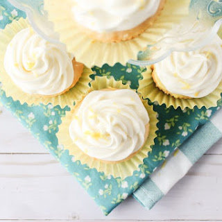 Lemon Pudding Poke Cupcakes with Lemon Cream Cheese Frosting.