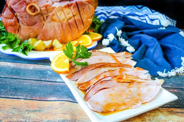 Slices Of Orange Coca Cola Ham On A Platter.