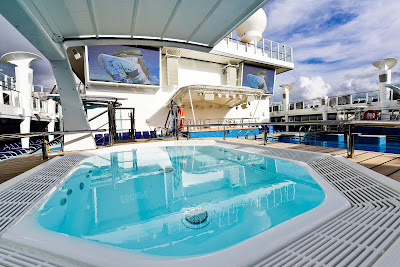 Sun lover's delight: Enjoy a few hours by the pool on board Norwegian Escape. You deserve it!