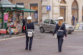 Photo: Municipal policewomen.  The centre of Perugia is a restricted traffic zone with hefty fines for those caught (on camera) for driving without permits.