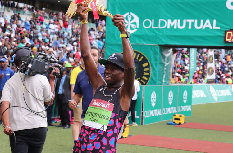 Bongmusa Mthembu celebrates winning the 2018 Comrades Marathon on June 10 2018 in a time of 5:26:39