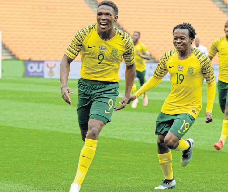 Bright future: Lebo Mothiba and Percy Tau celebrate a goal in the qualifier against Seychelles in October. Bafana coach Stuart Baxter says hosting the 2019 Africa Cup of Nations tournament in SA will benefit young players such as Tau and Mothiba. Picture: FRENNIE SHIVAMBU/GALLO IMAGES