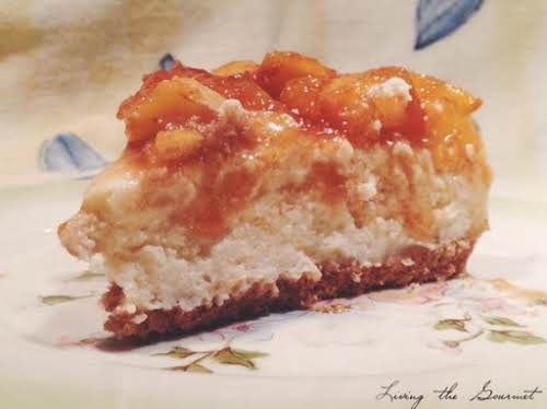 "Cheesecake with Fresh Peach Topping ""This rich, decadent cake, topped with the..."