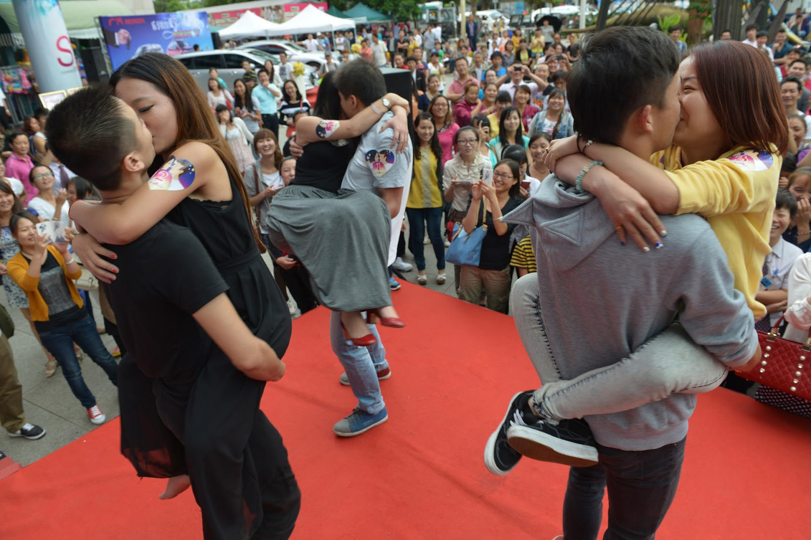 Couples at a Qixi kissing contest in Yunnan duking it out on who can kiss the longest (Credit: China Foto Press)