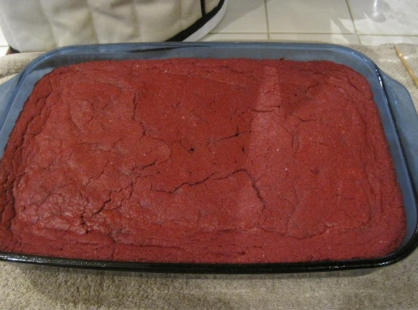 Preheat oven to 325. Combine cake mix, melted butter, eggs, pudding mix, vegetable oil,...
