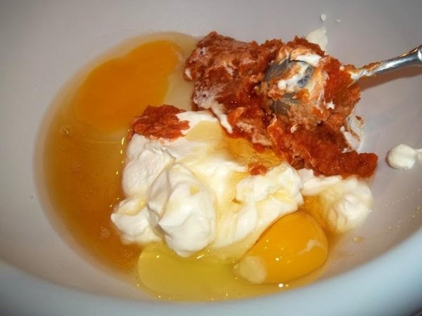 In another bowl, mix the butter, pumpkin, sour cream, eggs, honey until blended well...