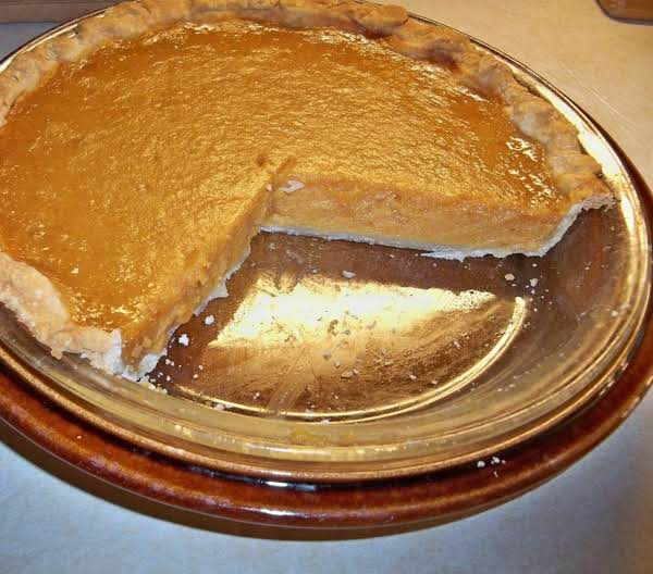 A Sweet Potato Pie With Pieces Missing