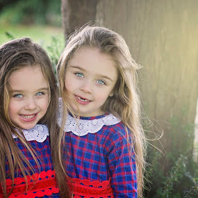 twin smiles by Melissa Marie Gomersall - Babies & Children Child Portraits ( kids in the summer, raining, tree, twims, bright, shine, cute, twins, spring, sun,  )