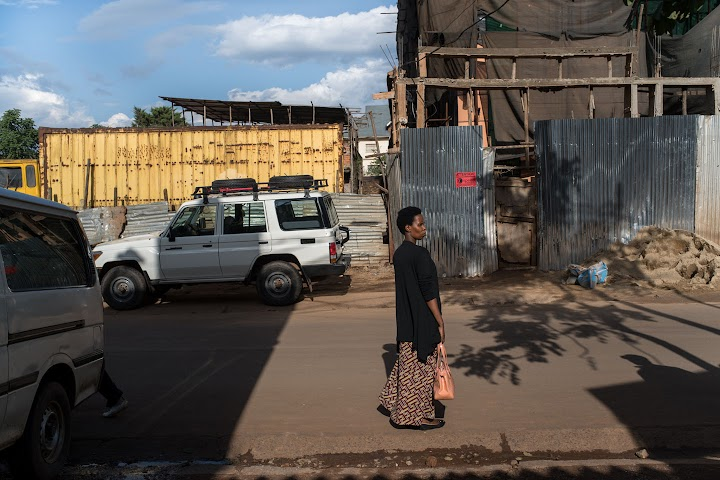 Clementine walking along a street in Bukavu, Democratic Republic of Congo.