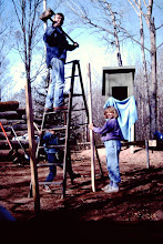 """Photo: """"Hired help"""" laying out cabin and drilling post holes."""