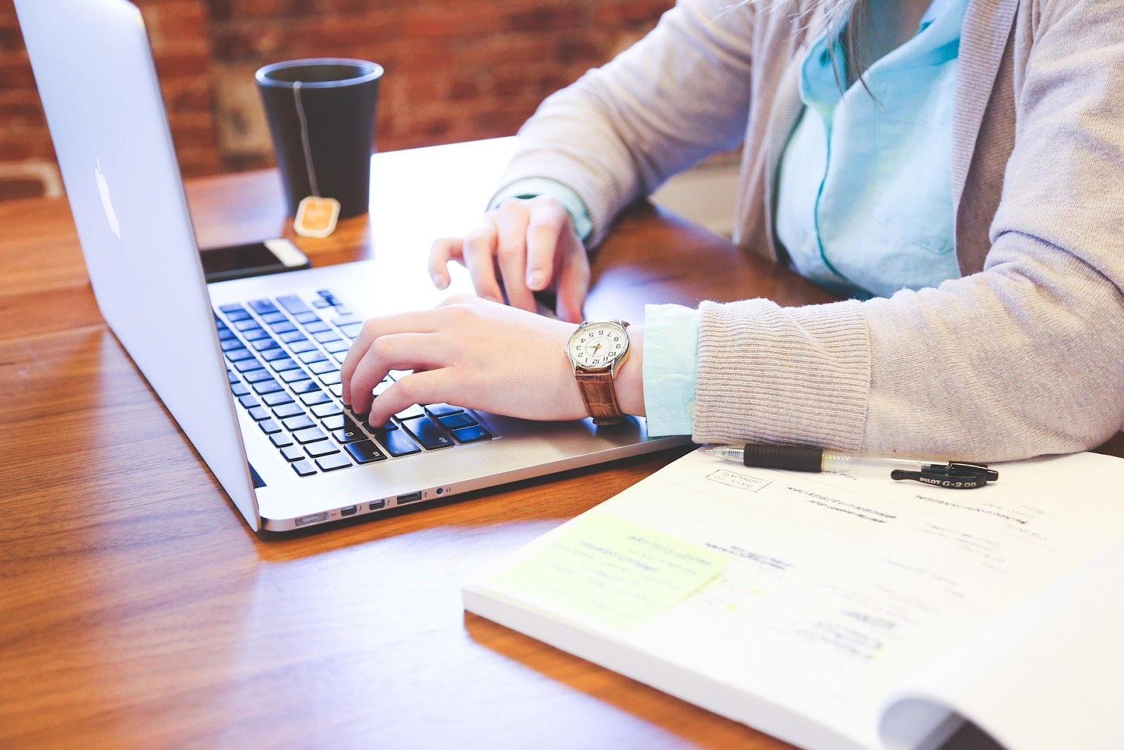 woman open laptop marketing small business tips