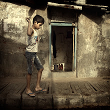 Photo: When faced with something in their way that can test balancing skills, kids all over the world (and probably adults too) will always accept the challenge to walk it. Mumbai, India. www.michiel-delange.com #streetphotography  #streetphotographers