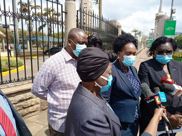 Nyanza MPs: Rozza Buyu (Kisumu), Christine Ombaka (Siaya), Pamela Odhiambo (Migori), Tom Odege (Nyatike)and James Nyikal (Seme) address a press conference outside Parliament Building on shortage of ARVs and other HIV commodities in the region.