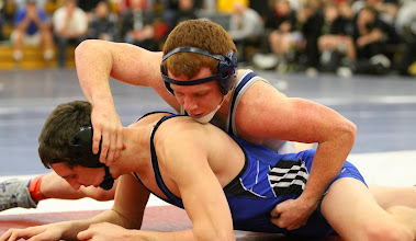 Photo: 160 Paden Moore (Jackson County Central) over Noah Ryan (Kasson-Mantorville) Fall 2:39. Photo by Mark Beshey