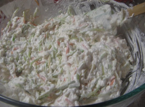 In a large bowl, mix the cottage cheese, Parmesan cheese, sour cream,cream, salt, pepper...