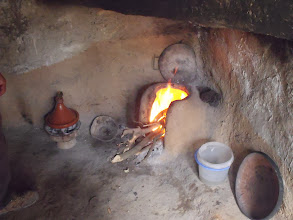 Photo: Bread oven on the right, and tagine cooking over coals on the left.