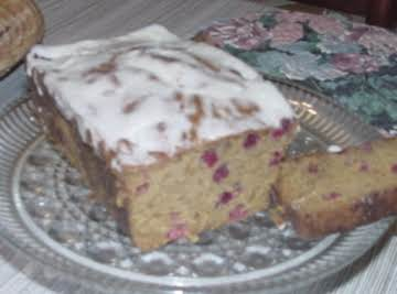 Pumpkin cranberry bread with orange glaze