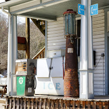 Photo: Old gas pumps and ice machine on porch of Country Store
