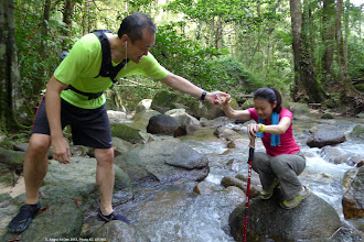 Photo: Help is needed in maintaining balance for a dry crossing