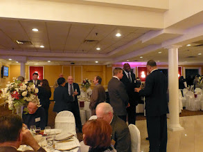 Photo: Cocktail hour provided opportunities for the business community to meet with government officials.