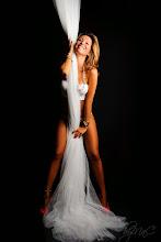 Photo: ©2014 byMaC Photography - bymacphotography.com #2014 #blonde #boudoir #bymac #drapes #hair #legs #lingerie #low key #smile #studio #teeth #watch
