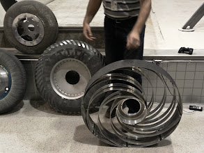 Photo: A rover wheel prototype with sandpaper for tread, to the left of that is a test replica of the Apollo lunar rover wheels