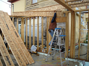 Photo: August, rain, and the first floor truss joists start being put in place.