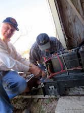 Photo: John Walton and George Schilp trying to fix Peter Bryan's critter without the drawings.  One loose wire found.    C&IG 2014-0318 RPW