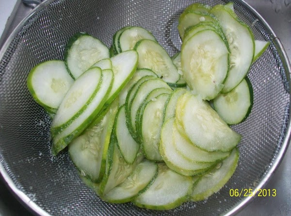 On your mandolin or with a very sharp knife, slice the cucumbers with your...