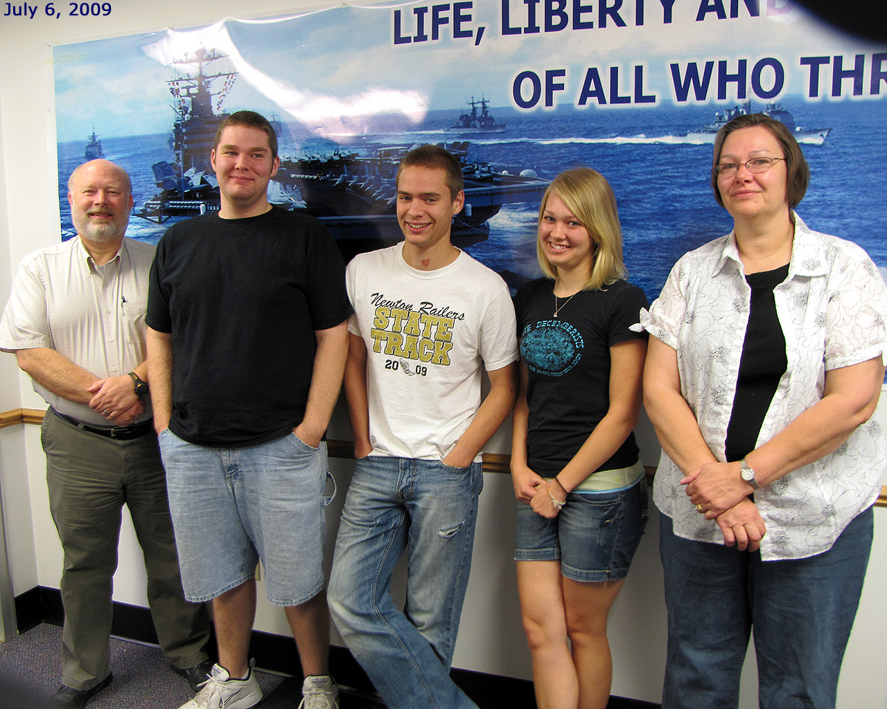 Photo: Hutchinson, KS area Recruiting Office.  A few minutes before K. Henry left for boot camp @ Naval Station Great Lakes, North Chicago, IL 06-Jul-09. (photo taken by YN2 Michael Adams)
