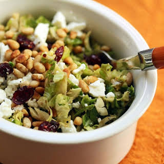 Raw shaved Brussels sprouts with dried cranberries, feta and pine nuts {vegetarian, gluten-free}.