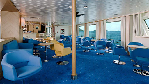 After a day exploring the Galapagos, relax in the spacious lounge aboard La Pinta.