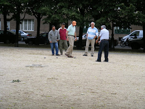 Photo: Following a stroll along the Seine banks, we metro over to the Esplanade des Invalides, which is typically animated on a Sunday afternoon. Several boules matches are underway on the hard packed dirt areas.
