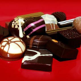 LUXURY CHOCOLATES by Karen Tucker - Food & Drink Candy & Dessert ( luxury chocolates, red plate, stillife, still life, milk chocolates, yummy, soft centres, white chocolates, tasty, sweet, chocolates, candy, food, naughty but nice, comfort food, plain chocolates, dessert, treat )