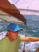 Photo: At the helm on a close reach off Sandy Cay