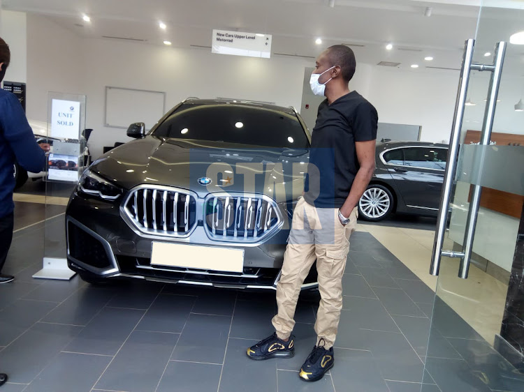 Maina Kageni with his brand new BMW 2020 X6
