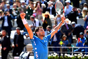 Dominic Thiem of Austria celebrates at match point during his mens singles semi-final match against Novak Djokovic of Serbia during Day fourteen of the 2019 French Open at Roland Garros on June 08, 2019 in Paris, France.