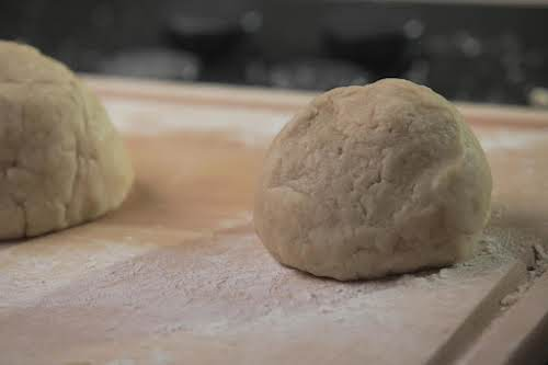 Step 4. Lightly flour a clean work surface. Form dough into two...